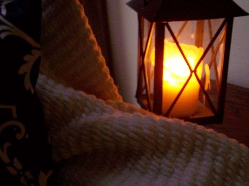 Relaxing with blanket and lantern
